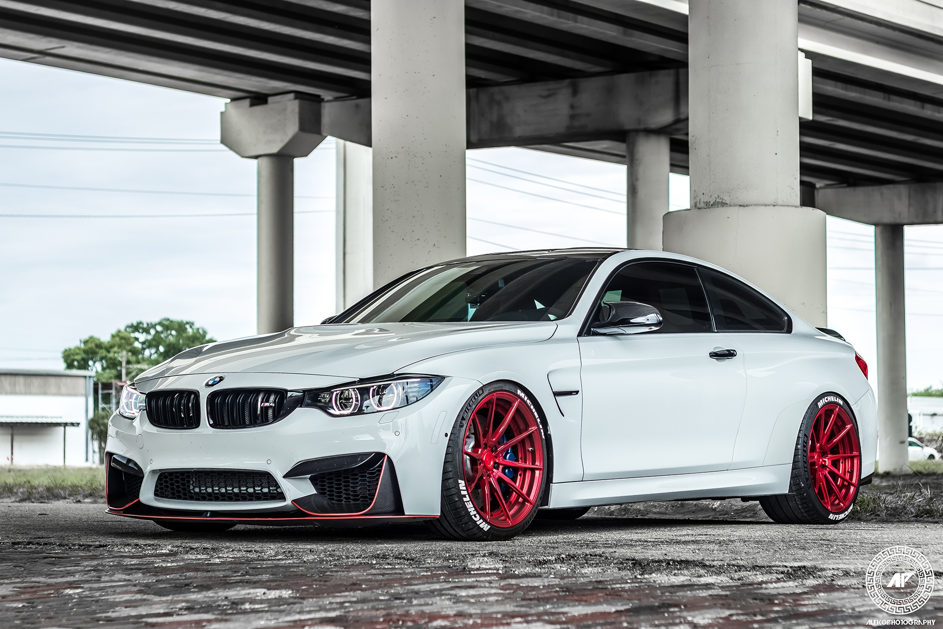 bmw m4 with 702whp and bright brushed red wheels